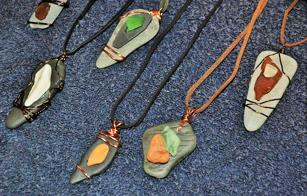 Wire Wrapped Beach Glass and Stone Pendants! These are made from beach glass, stone, brick, and pottery collected at Lake Cayuga, New York, this past summer. These pendants are on either suede or leather cord that can be tied behind the neck.  Art Rains Jewelry